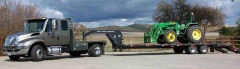 semi truck hauling a tractor
